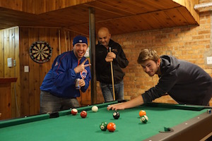 A great game of pool is happening at Wrigley Hostel in Chicago!