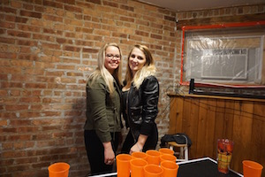 The girls started a beer pong game at Wrigley Hostel!