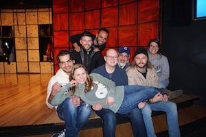 The group poses for a picture on stage at Comedy Sportz