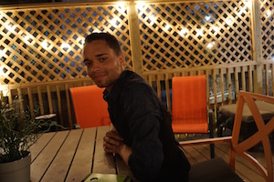 Demitri is hanging out on the deck at Wrigley Hostel!